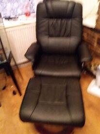 Black leather chair with stool