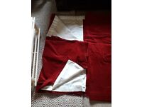 Thick red velvet curtains, fully lined