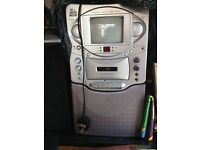 The singing machine with Compact disc, cassette player, graphics TV Karaoke