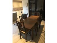 Dark wood table with 6 dining chairs
