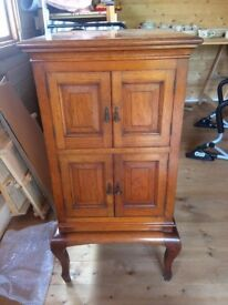 Wooden gramophone cabinet for sale.