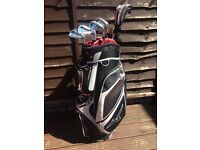 Complete set of Mizuno MX950 irons, Taylormade Rossa putter and Mizuno Bag
