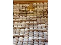 Baby's hand knitted pram cover