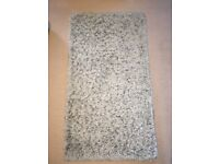 Small grey rug