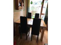 Heavy solid oak extendable table & four excellent modern chairs