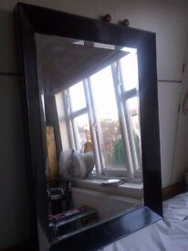 large modern mirror with substantial wooden frame