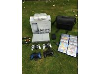 Satin Silver PS2 package includes console, 4 controllers, multitap, 10ganes, carry bag