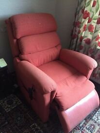 Nearly new electric Riser Recliner Chair in Terracotta