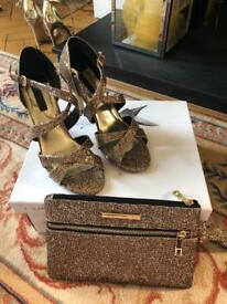 Gold ladies sandals and matching bag worn once excellent condition