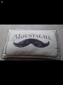 Moustache bed cushion