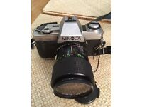 Minolta X-300 35mm SLR Camera, travel case, zoom and wide lenses, with flash and remote release .
