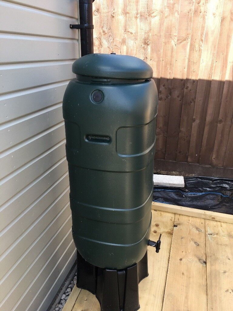 Water butt in unused condition with stand and fittings