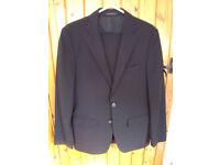 Zara Man black wool man's 2-piece suit. eur 36/usa 36/mek 36 jacket; eur 40/usa 31/mek 31 trousers.