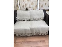 2 Taupe woollen throwvers