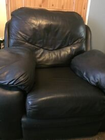 super comfy brown leather sofa with matching arm chair and storage box/leg rest