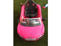 Pink Audi R8 Spyder with canopy