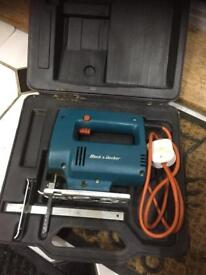 Pre owned black and decker Jigsaw with various speed settings in box