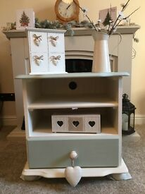 Small cream and sage green, one draw cabinet.