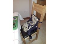 Child's booster seat for dining table etc.