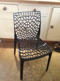 Perpex smoked charcoal chairs .