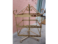 Ear ring / jewellery stand. Gold colour. East Belfast area