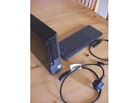 Dell Optiplex 780 Ultra Small Form Factor P.C. with a Logitech K400 Plus Keyboard