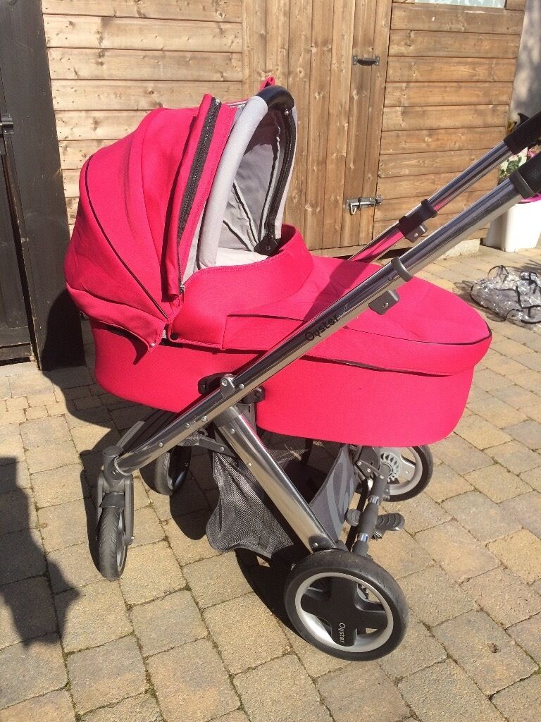 Beautiful raspberry colour complete Oyster pram set, pet free smoke free home, excellent condition.