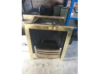 Kohl a gas fire with brass surround