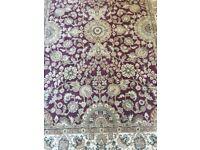 Red traditional design patterned rug