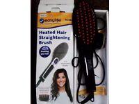Heated straightening hair brush never used. As seen on tv. £15.