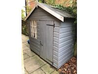 Grey wooden playhouse
