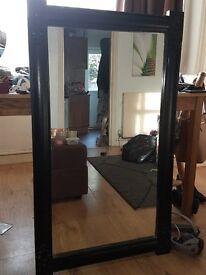 Black mirror with corner details
