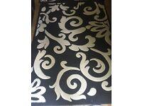 Black and cream large rug