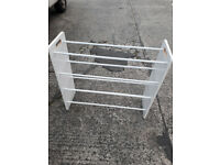 child,s white wood clothes airer rail