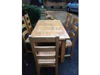 Solid oak extendable table and 6 ladder back dining chairs