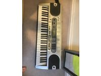 Casio keyboard with pedal and metal stand (new keyboard cost £90+ and stand £50+)