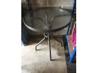 Garden glass and metal bistro table in good order - no chairs just the bistro table