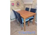 KITCHEN TABLE AND FAUX LEATHER CHAIRS