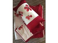 Red king size bedding with white band with red flowers