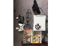 Xbox 360 with Kinect, 2 controllers, guitar and 5 games.