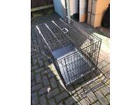 Metal dog crate.