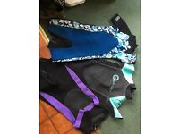 3 shortie Wet Suits Never used. 2 Boys and 1 Lady