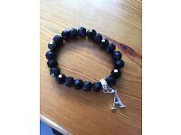 Black Thomas Sabo bracelet with detachable A Charm