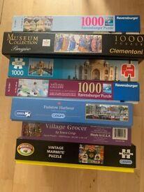 Various 1000 piece jigsaw puzzles