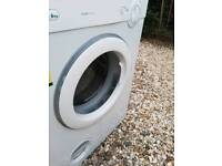 Free standing tumble drier