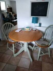 Kitchen table pine and green with 2 drop leaf & chairs. Strong