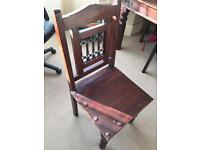Large dark wood dinning table and chairs