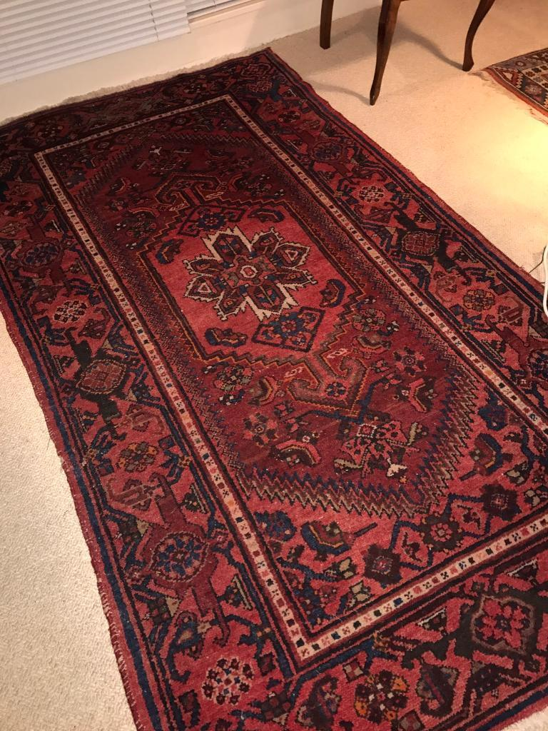 Red traditional Persian style wool rug 125cm x 210cm in good vintage condition