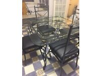 Glass and wrought Iron Dining Table & Chairs
