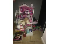 Girls stuff doll house pushchair baby's games helmet baby clothes DVD player printer lots more